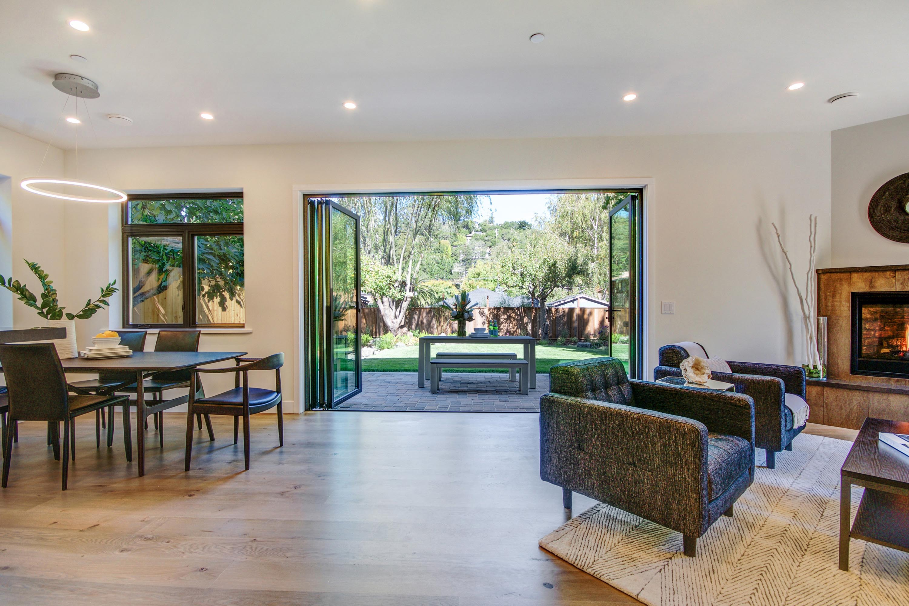 sustainable remodel with energy efficient folding glass wall and open concept design