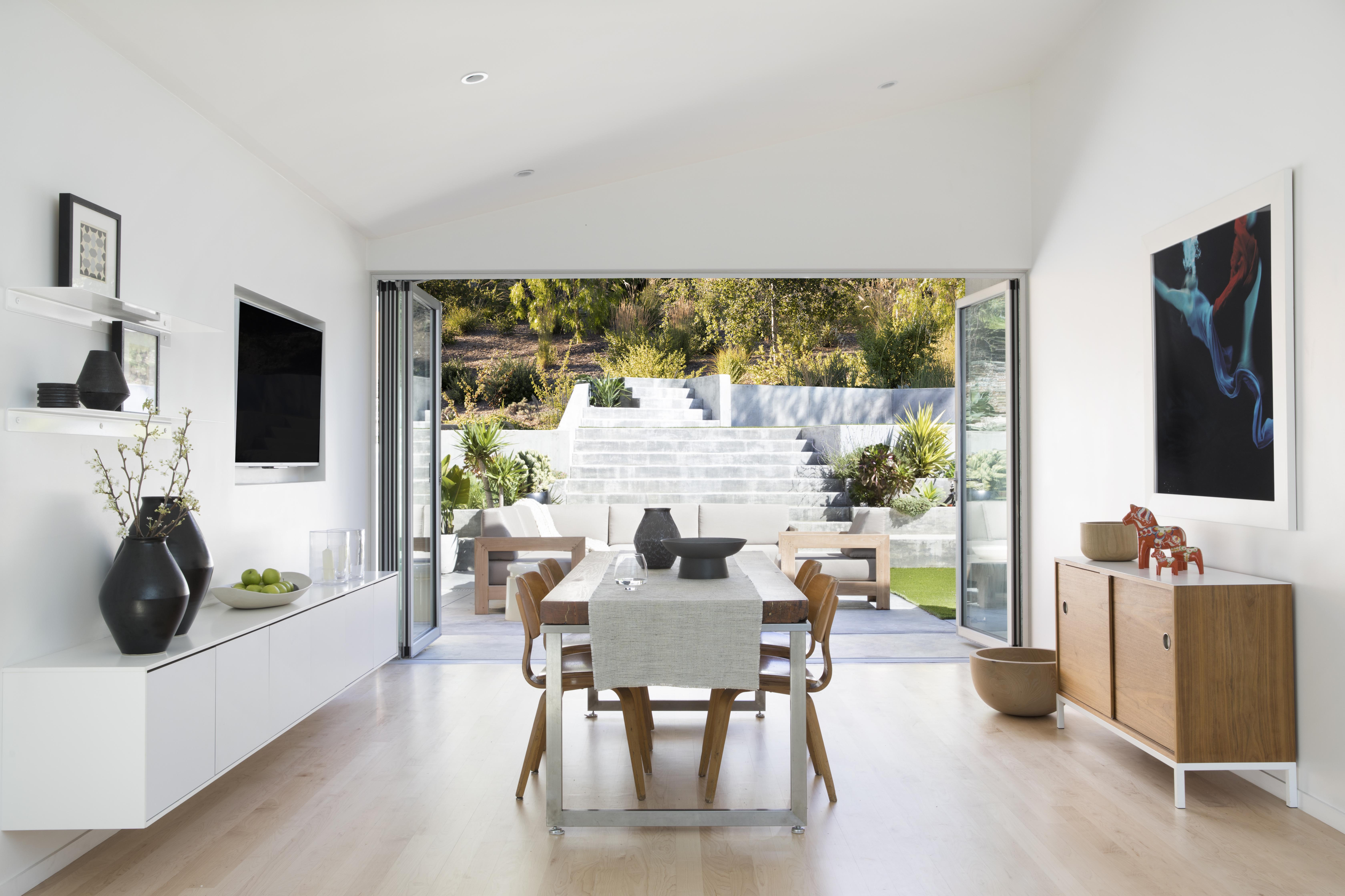 open concept remodel with folding glass wall