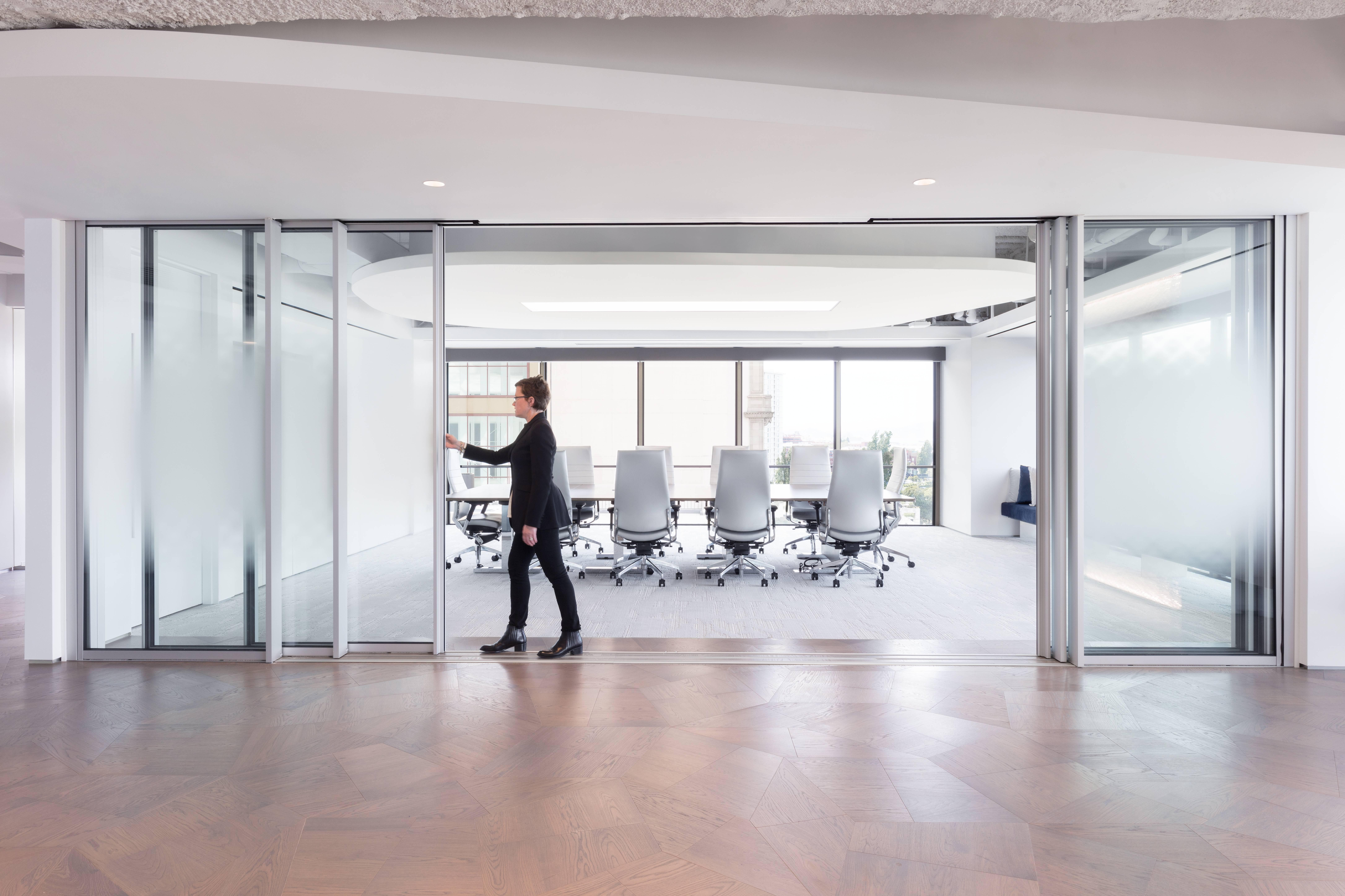 minimal sliding glass wall with beautiful aesthetics in an office