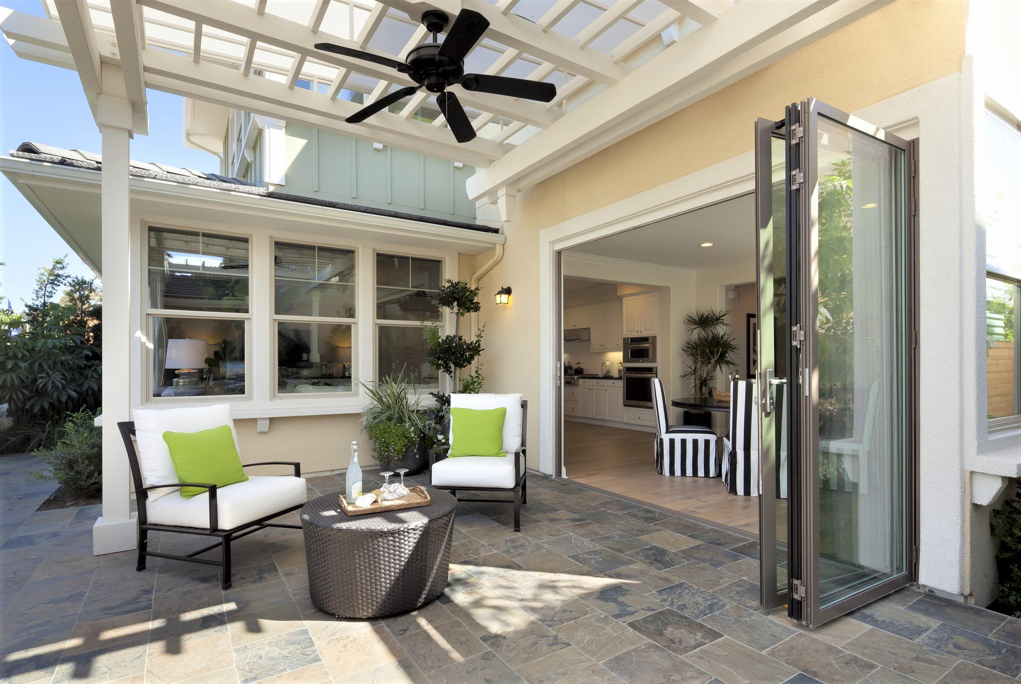 replacing traditional patio doors with folding glass walls