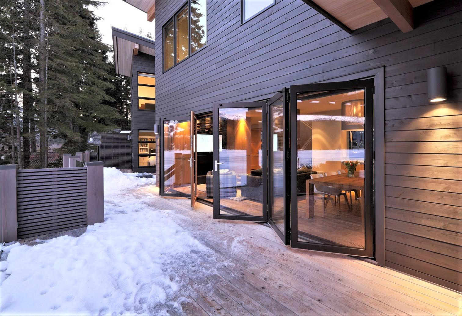 Folding glass walls replace a patio door and perform in harsh weather