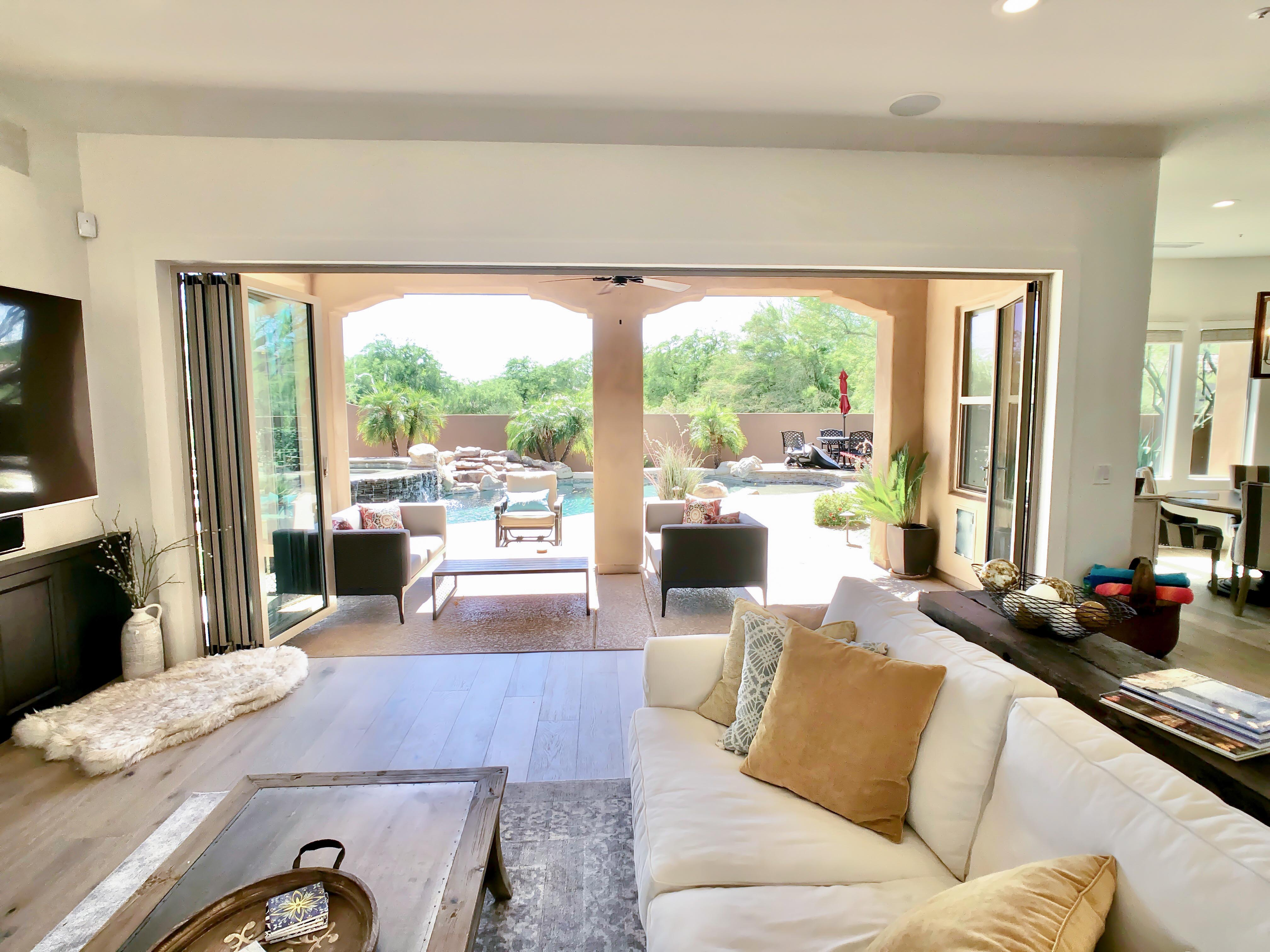 view out of remodeled family room through a folding glass wall
