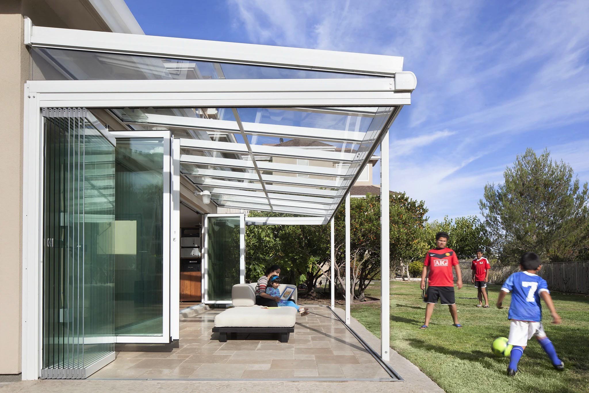 kids playing while bringing the outdoors in with opening glass walls
