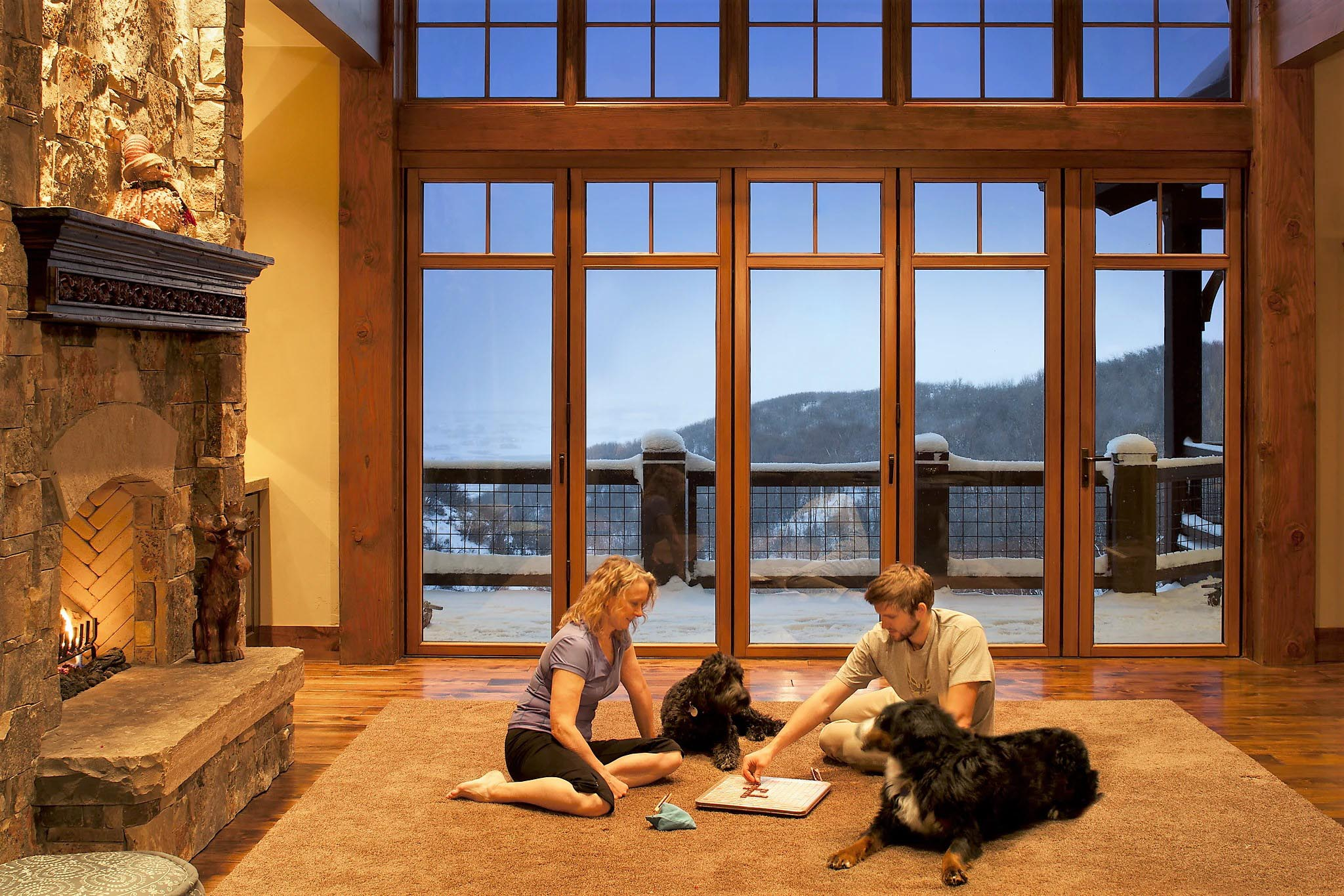 stay safe stay home family playing games in front of folding glass wall