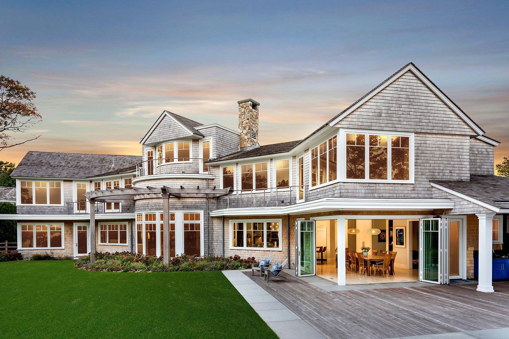 folding glass walls in traditional homes creates indoor/outdoor experience