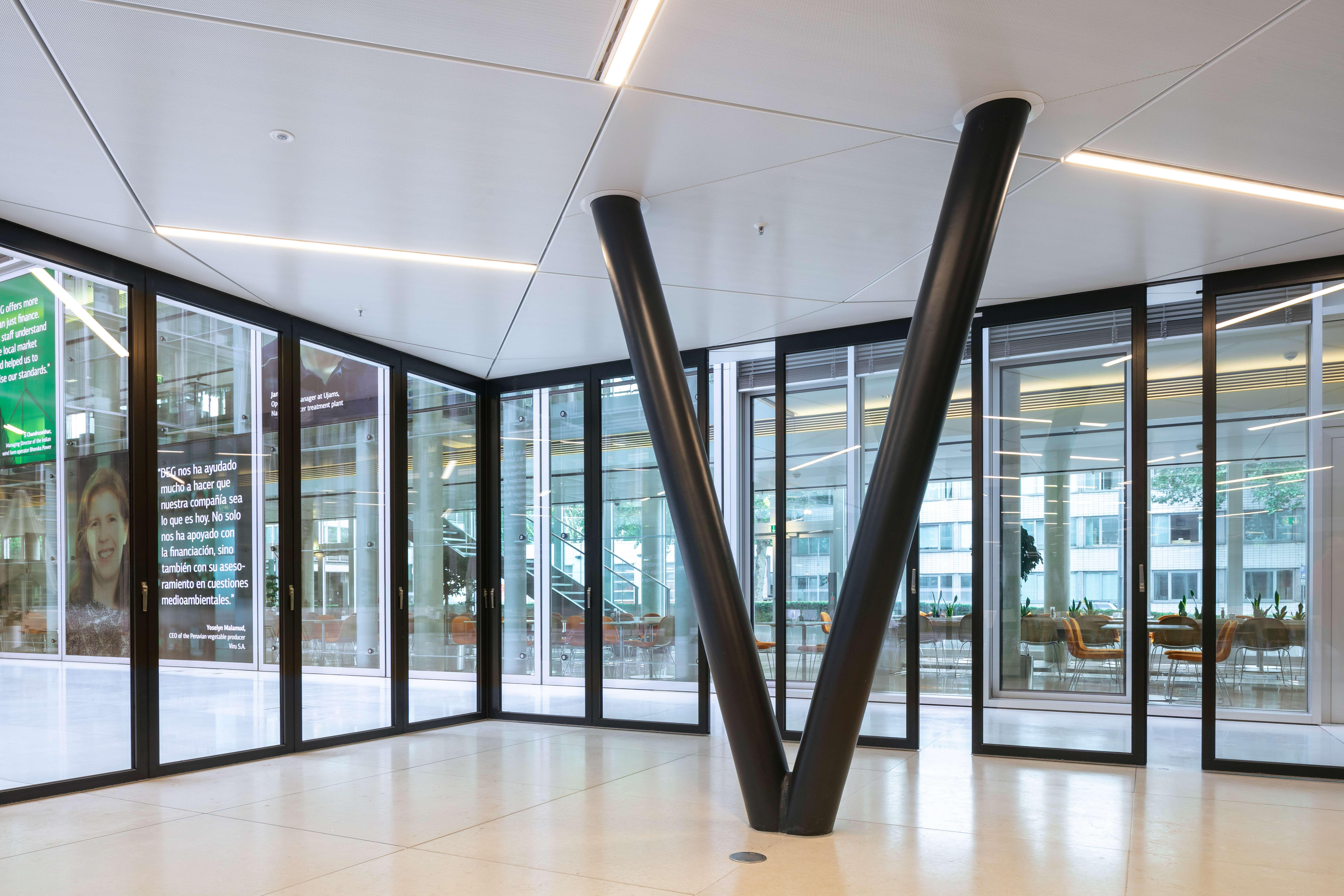 V-shaped structural supports and sliding glass wall levitate the conference room above