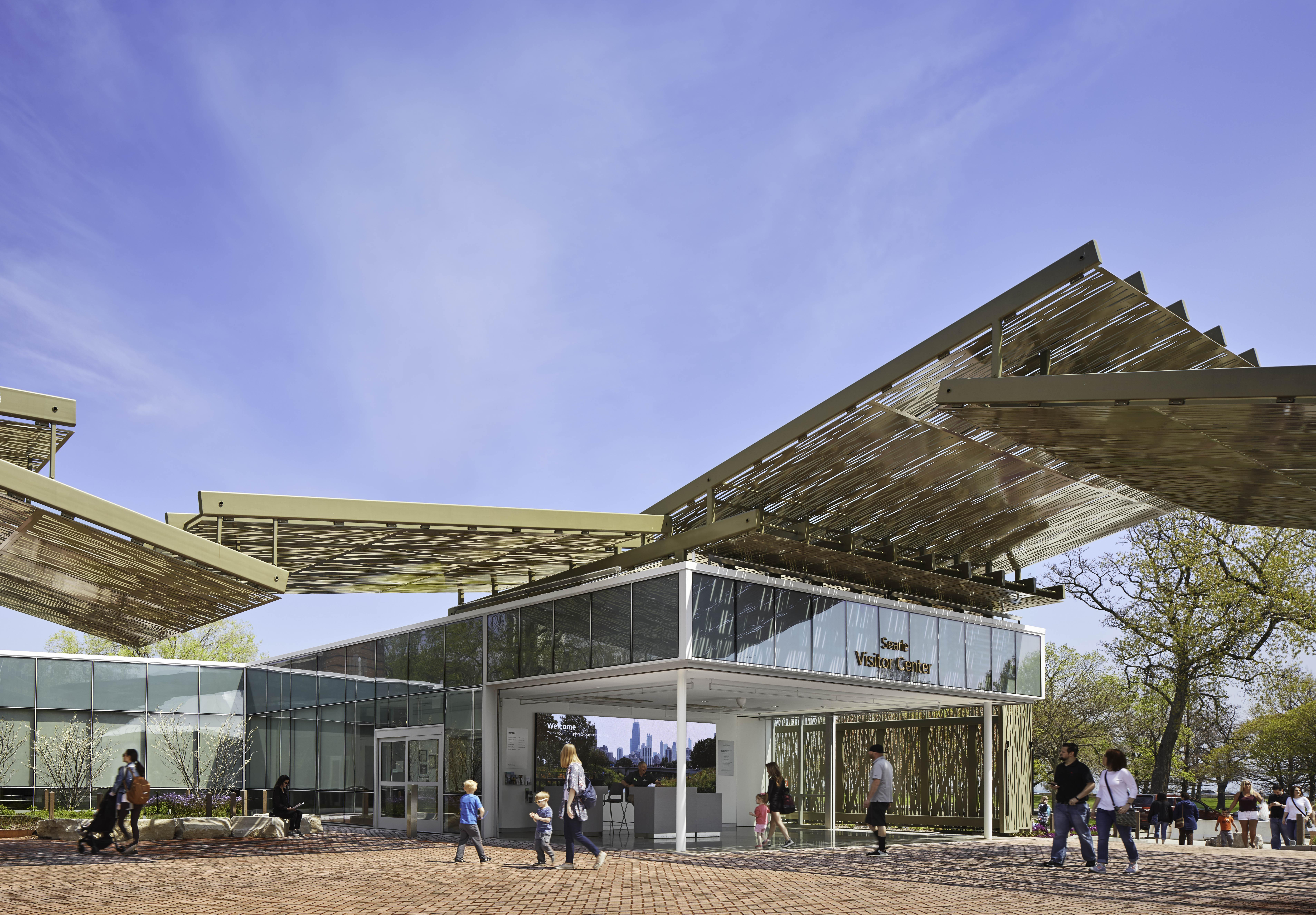 New visitor center with cantilever canopy and disappearing glass walls