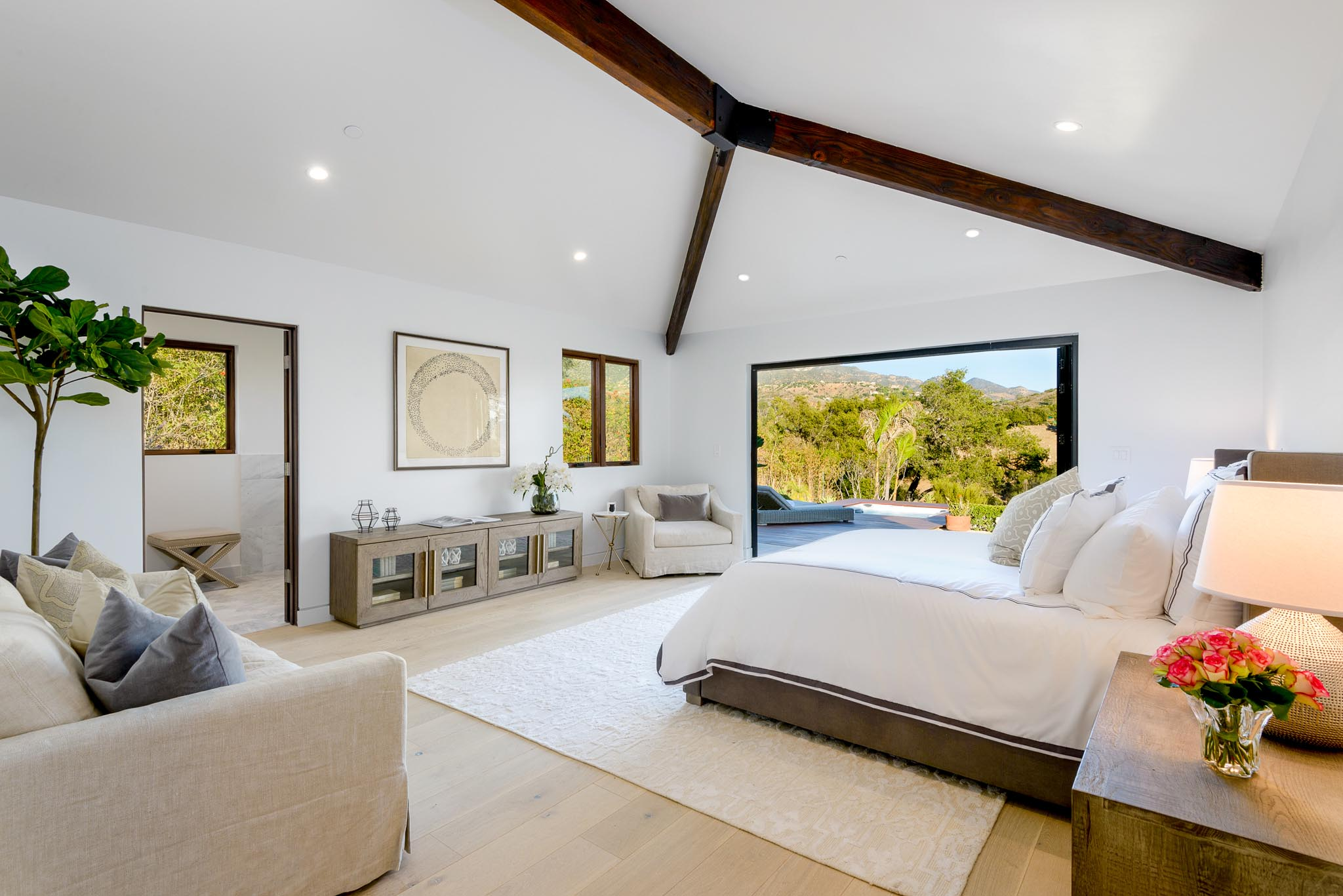serene retreat in master bedroom in contemporary ranch remodel with NanaWall FoldFlat system