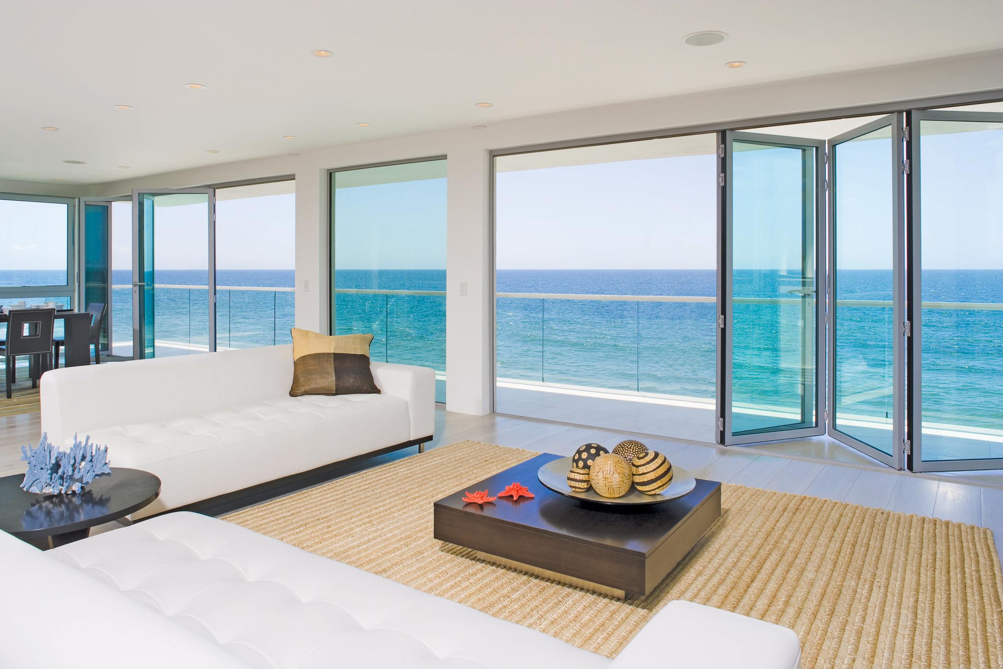 design inspiration in oceanfront home with opening glass walls