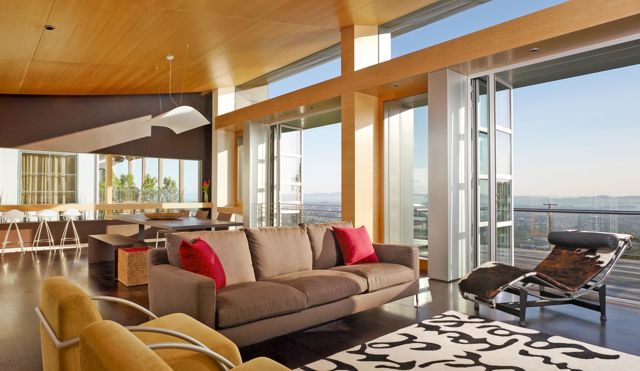 hillside modern home design inspiration with view through folding glass door