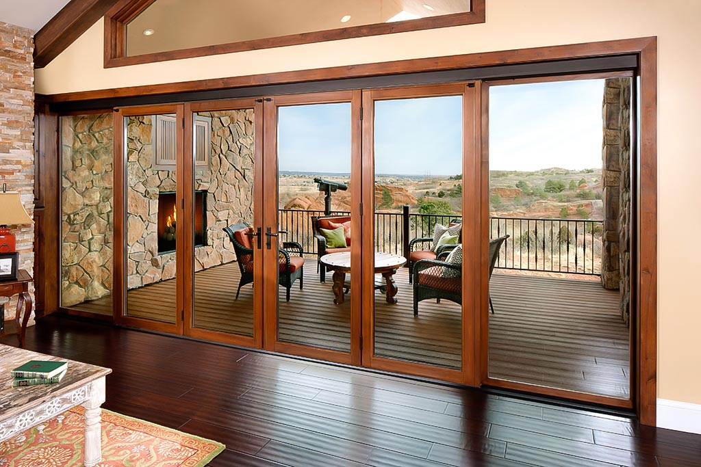 wood framed folding glass wall in traditional setting
