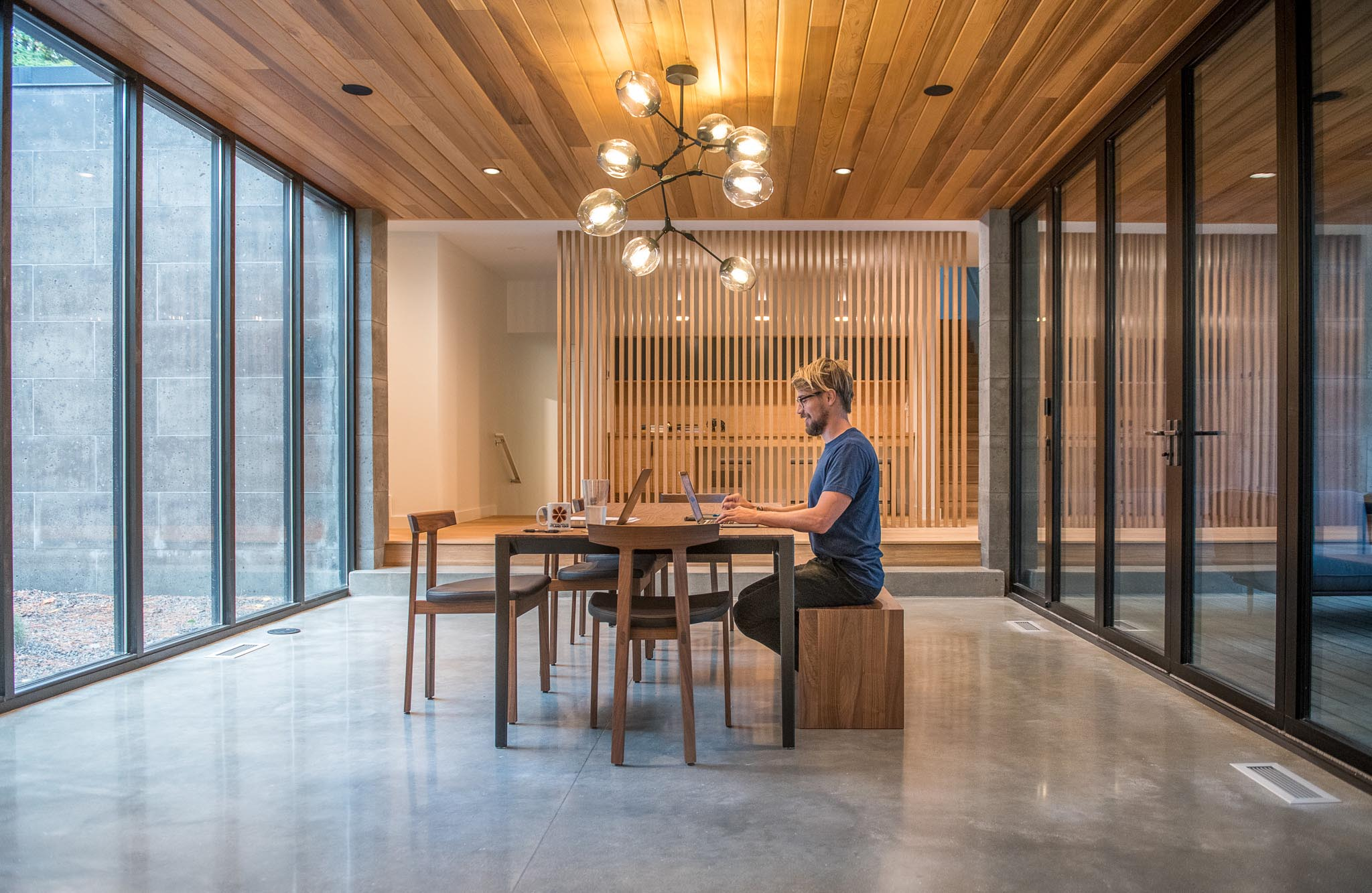 dining room becomes flexible work from home room with folding glass wall