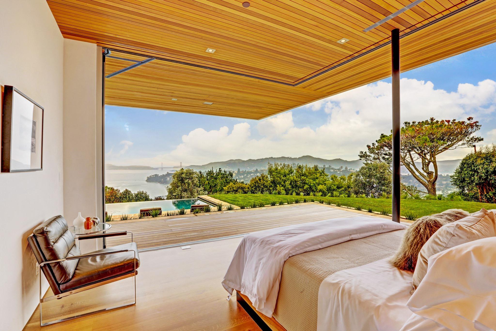 indoor/outdoor bedroom with open corner sliding glass wall