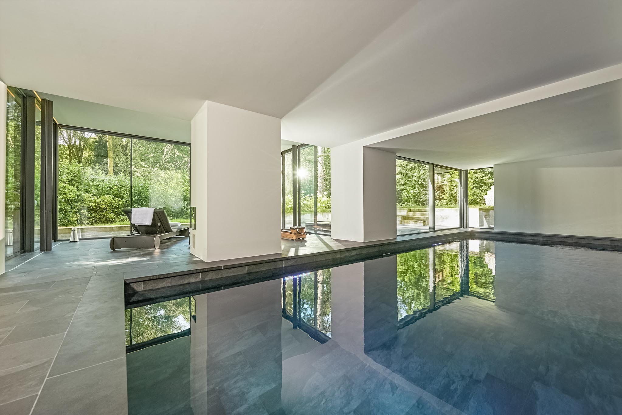 floor to ceiling cero minimal sliding glass walls in pool house