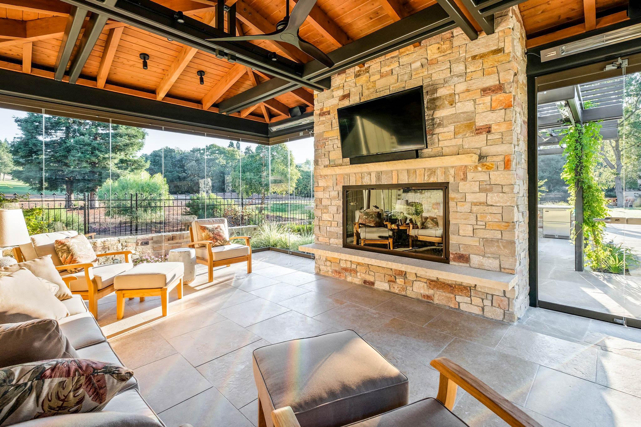 cabana design inspiration with frameless glass walls for indoor/outdoor living
