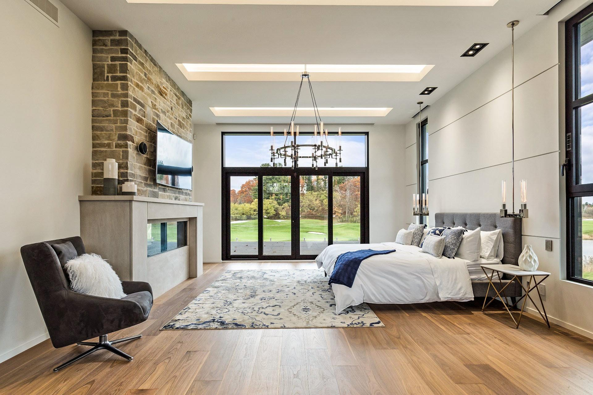 grand bedroom retreat with opening glass wall