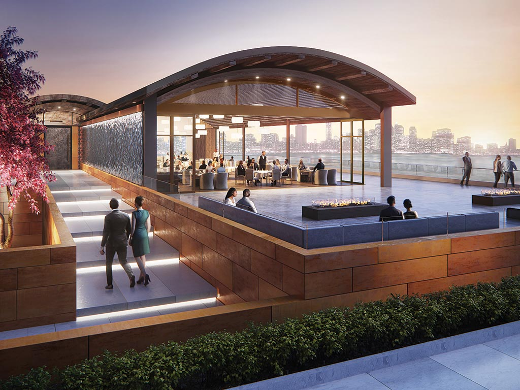 moveable glass walls in waterfront restaurant open to the patio and view