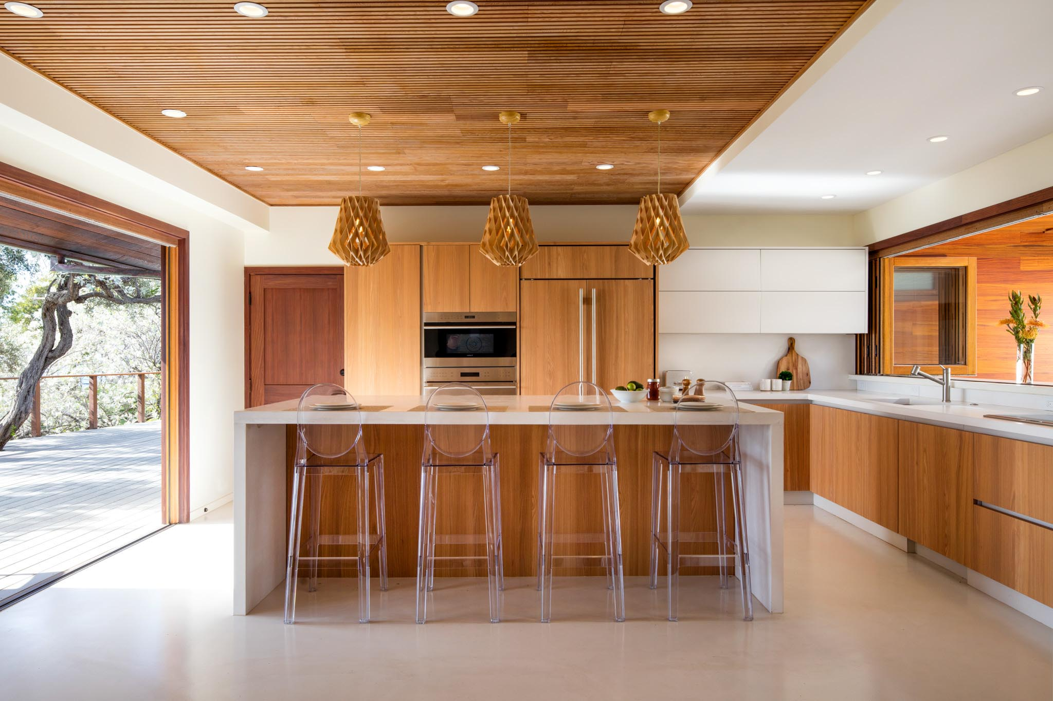 indoor/outdoor kitchen with two wood folding glass walls