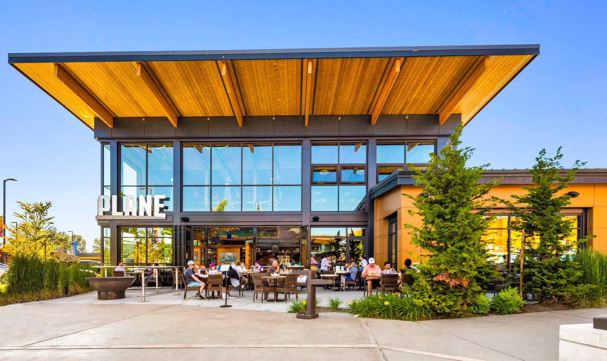 restaurant commercial design with moveable glass walls to eat outdoors