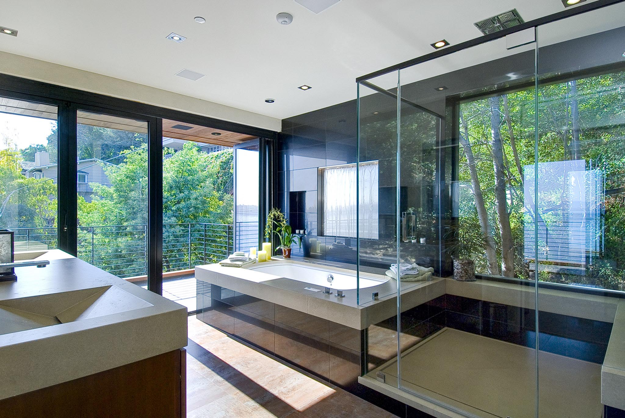 spa-like bathroom with folding glass wall open to freshair and natural daylight