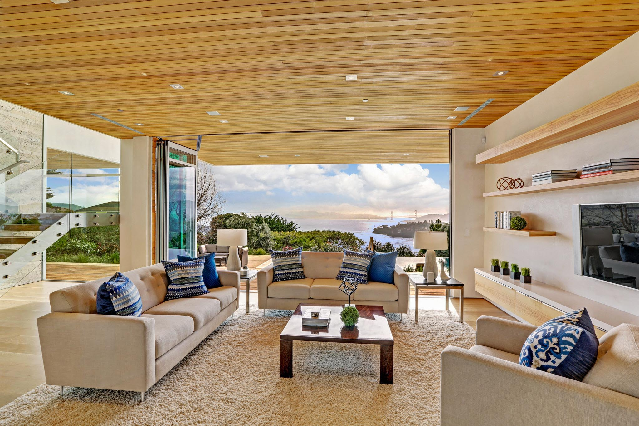 living room design inspiration with opening glass walls highlight view of golden gate bridge