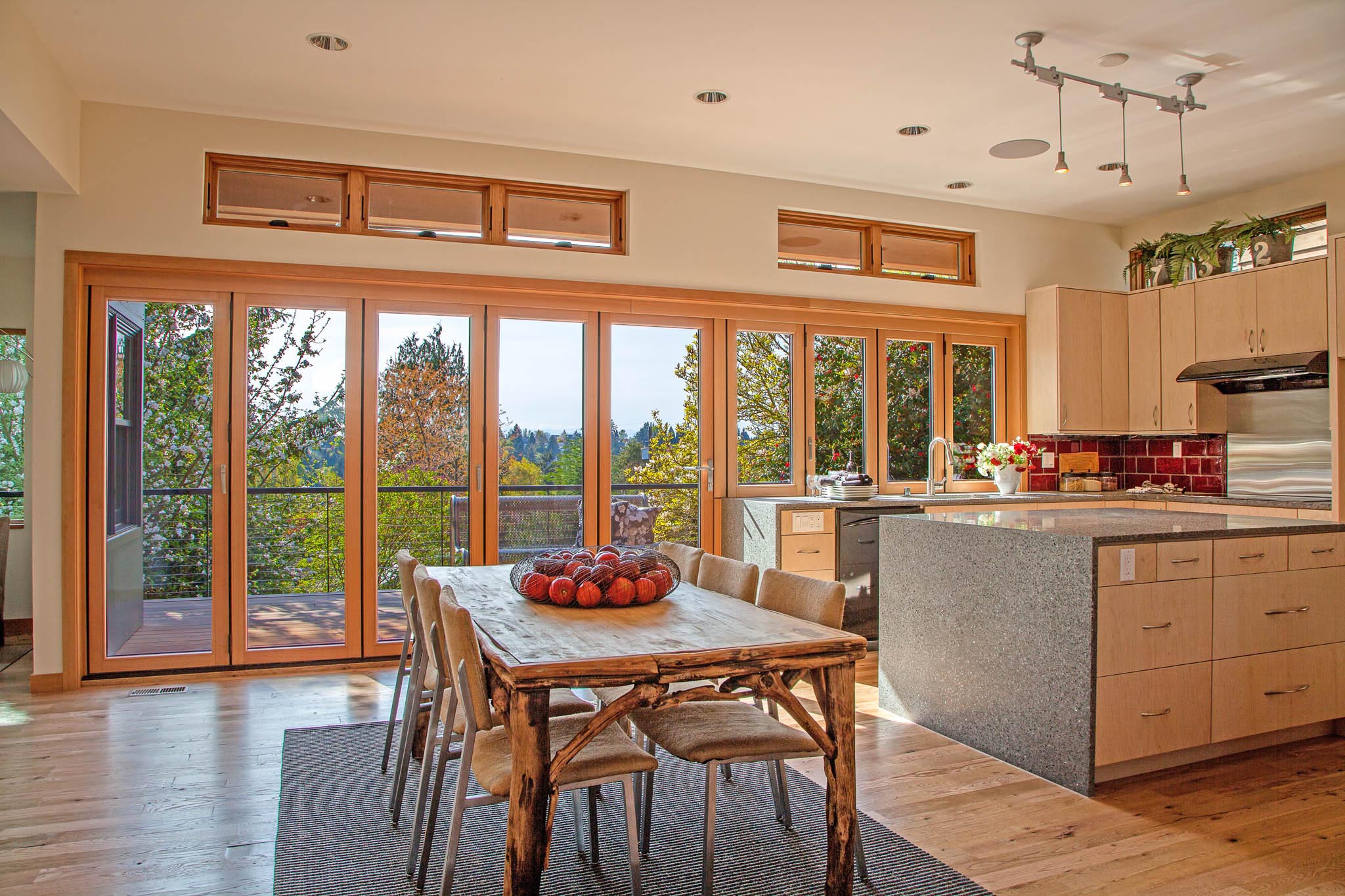 opening glass walls kitchen transition in wood in Seattle home