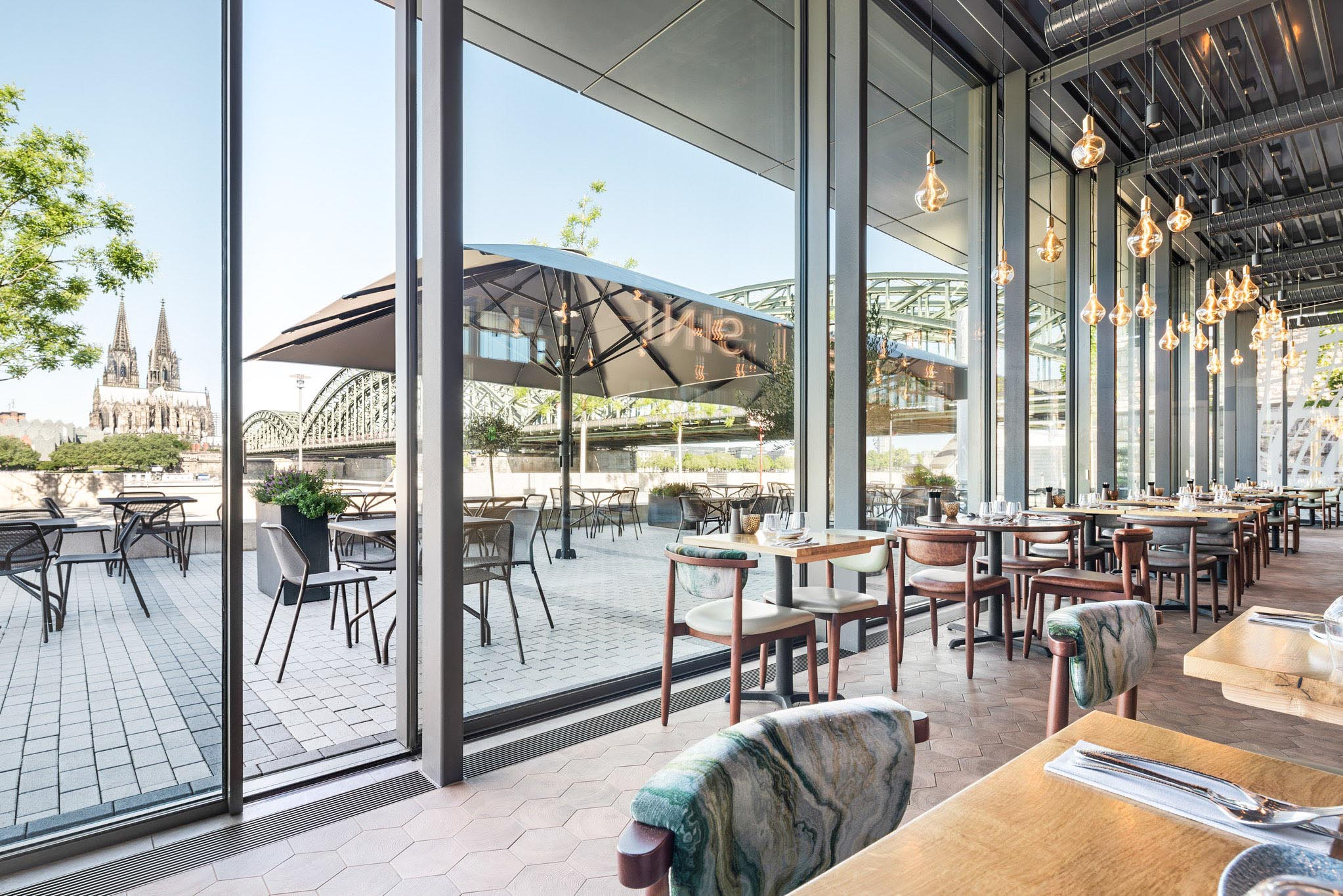 restaurant spaces designed with minimal sliding glass walls for fresh air and daylight