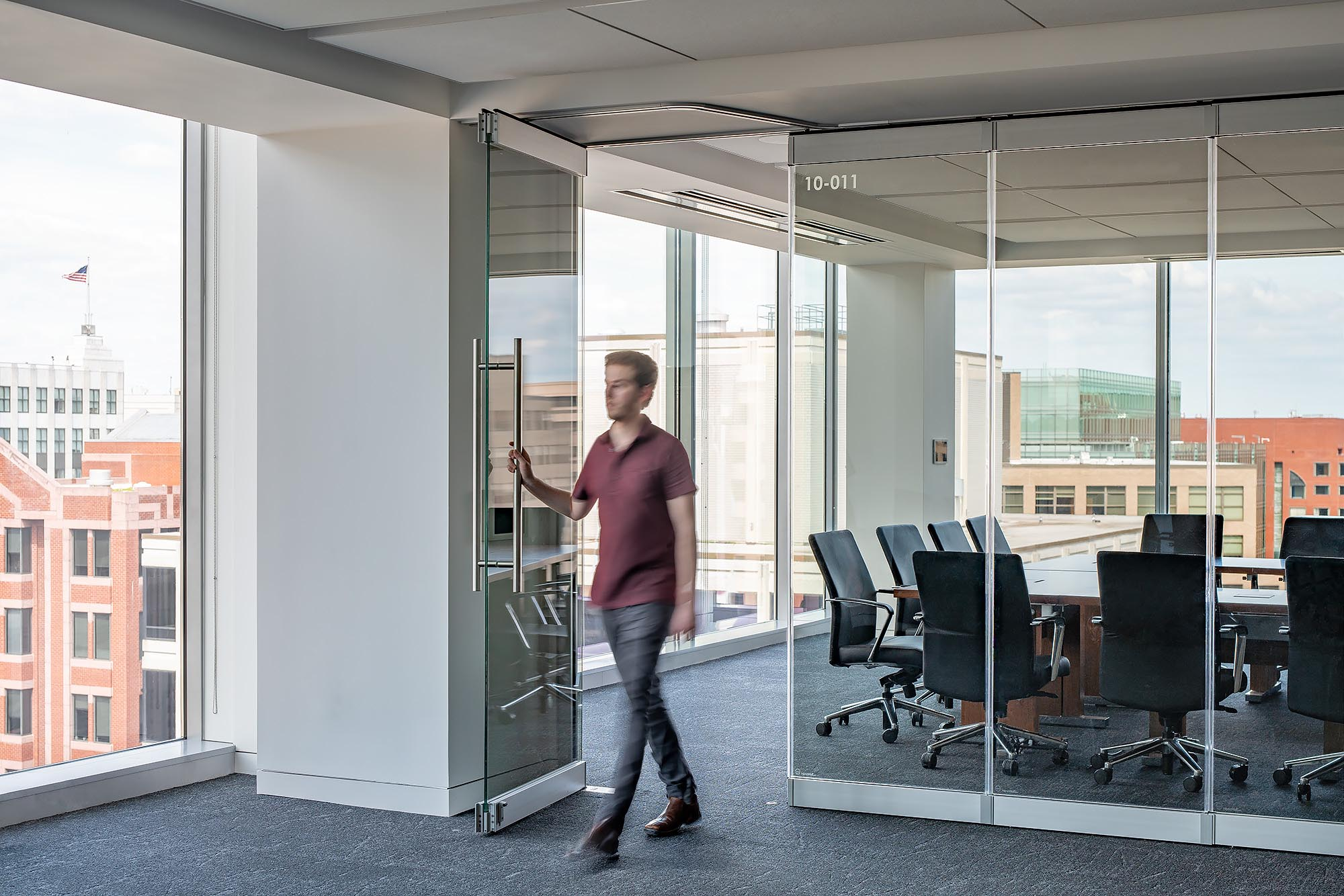 walking-through-swing-door-in-frameless-glass-wall