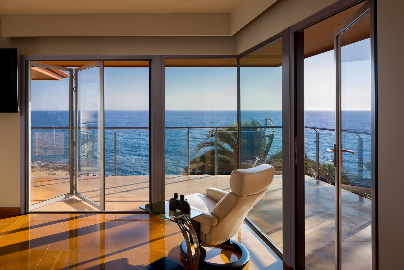 The best of beachfront our favorite seaside getaways for Opening glass walls