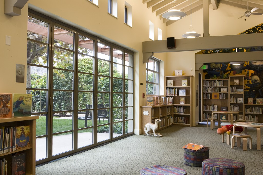 school-library-with-folding-doors-adds-natural-daylight-and-biophilic-design