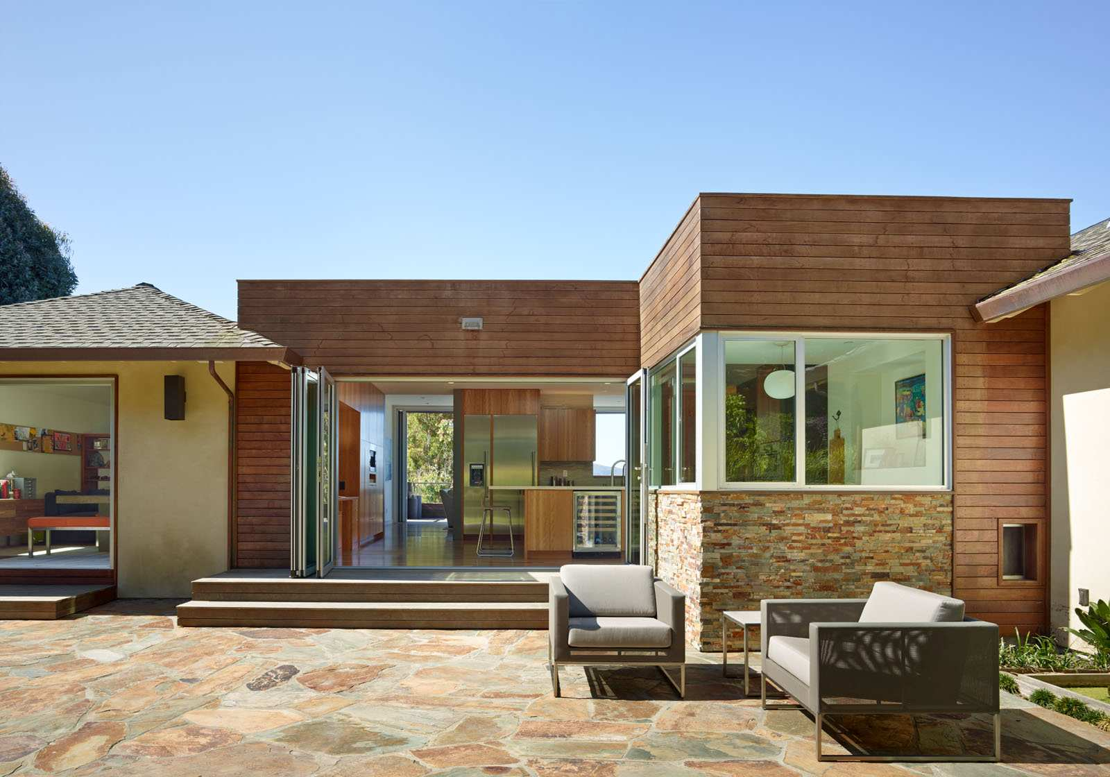 Mid-Century-Modern-exterior-with-NanaWall-glass-wall-system-connecting-kitchen-to-outdoor-patio