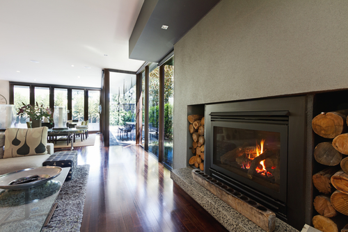 Tall-glass-living-room-windows-next-to-modern-gas-fireplace