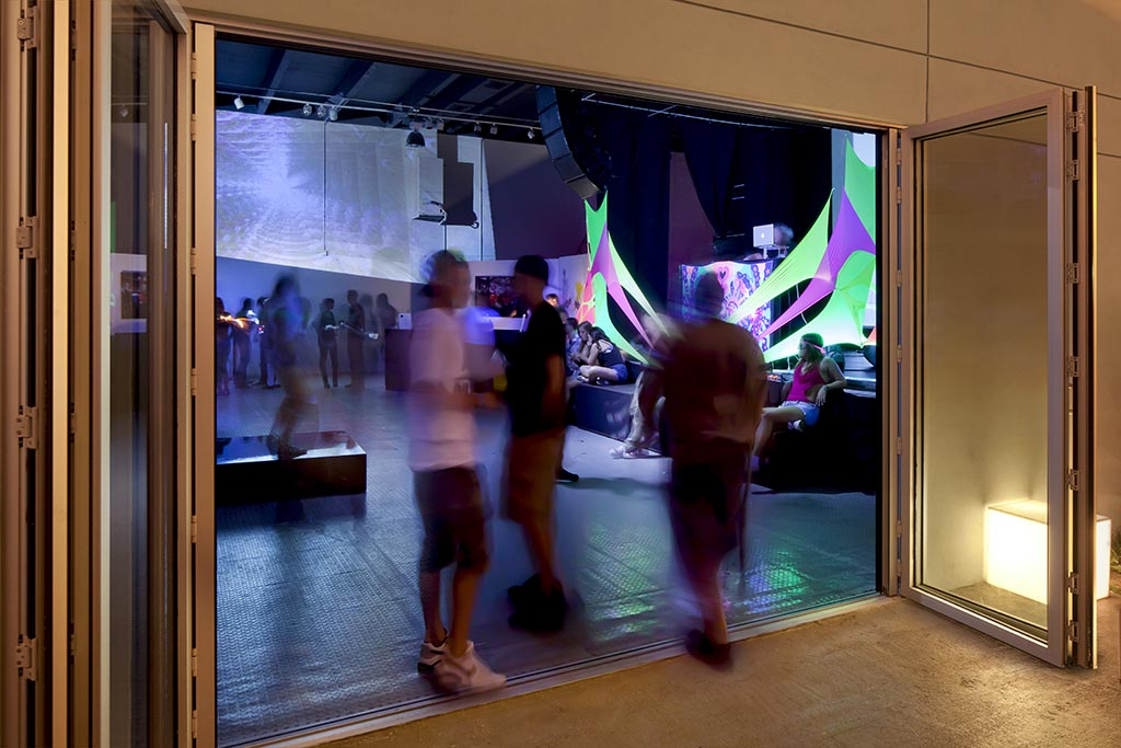 Awarehouse with NanaWall operable glass wall at party