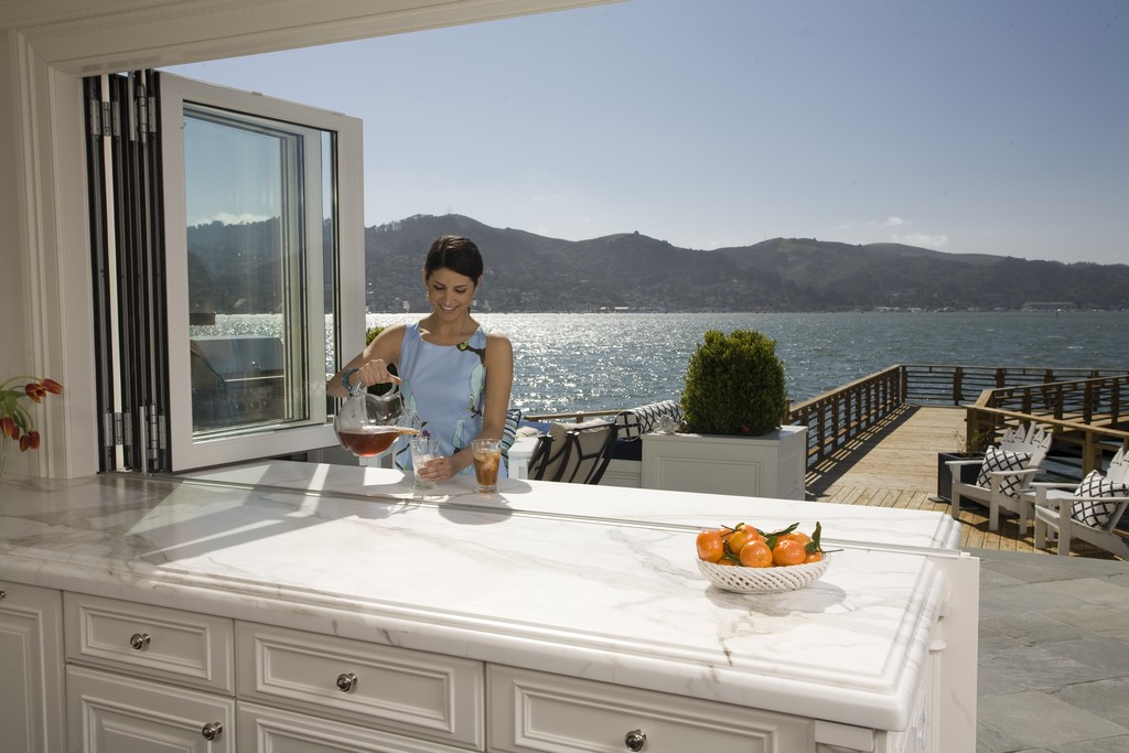 NanaWall folding window for kitchen allows in natural daylight and ventilation