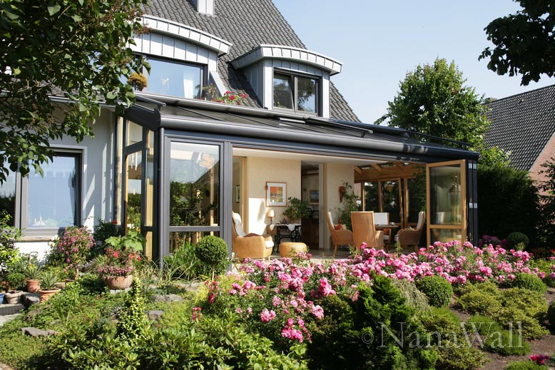 Solarium with lots of plants and folding doors