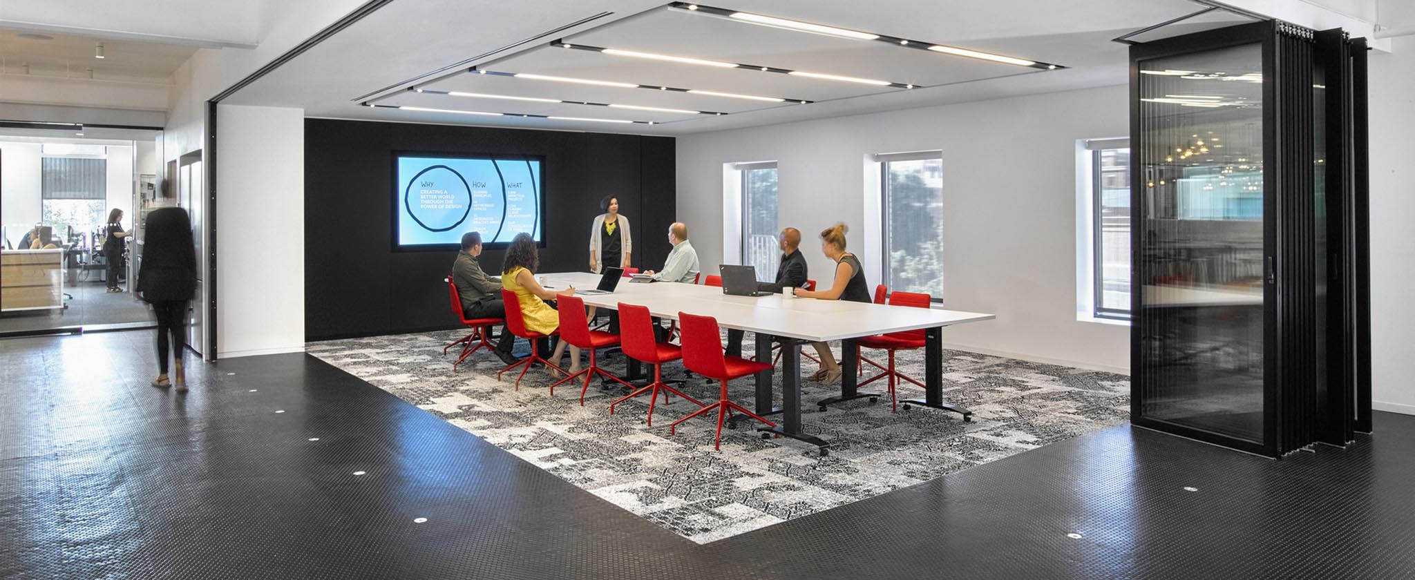 flexible conference room for office interiors with sliding interior glass wall